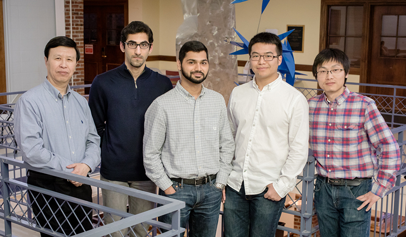 Image of mechanical sciences and engineering professor, Ning Wang and his graduate students.