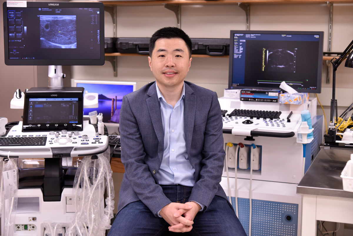 Photo of Pengfei Song with ultrasound machines