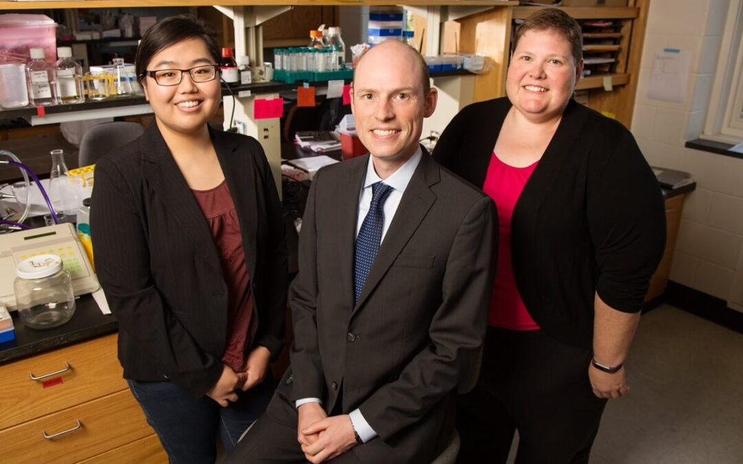 Pictured, from left: Postdoctoral researcher Amy Baek, professor Erik Nelson, and breast cancer survivor Sarah Adams.